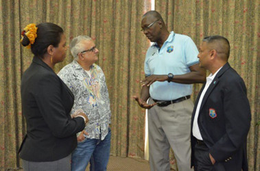 WICB director and legendary former fast bowler, Joel Garner (second from right) chats with senior counsel Anthony Astaphan during the Directors meeting while Corporate Secretary, Verlyn Faustin (left) and another WICB director, Anand Sanasie listen. (Photo courtesy WICB)