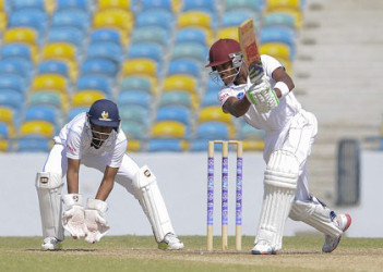 Orlando Peters drives during his 59 for Leeward Islands Hurricanes on the penultimate day of their fifth round match against Barbados Pride on Sunday. (Photo courtesy WICB Media
