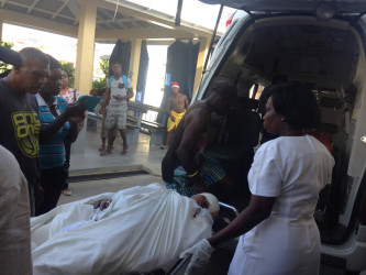 Injured Rookmaine Trotman being transferred to the Georgetown Hospital (Photo by David Papannah)
