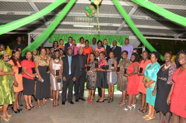 President David Granger (seventh from left) and GTU President Mark Lyte (sixth from left) with the awardees. (Ministry of the Presidency photo)