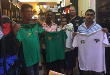 Representatives of Branderz Guyana, displaying the apparel supplied to the power lifting team prior to their medal heist in Canada. Also pictured in photo is Managing Director of the company, Martin Brock.