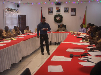 In this police photo Dr. Dennis Bassier speaks to members of the Administrative Performance Group.