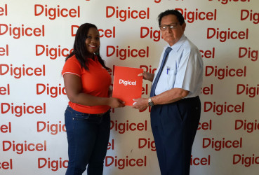 Digicel's Sponsorship Executive, Louanna Abrams, and president of Kennard's Memorial Turf Club, Cecil Kennard, pose for a photo during the ceremonial handing over of support on Wednesday at Digicel's Head Office.