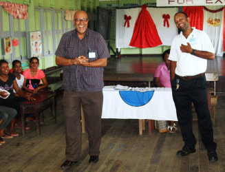 Dr Richard Van West-Charles  (left) and Divisional Manager Jim Ramjug (GWI photo)