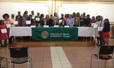 Seated from left: Director of Foreign Policy and Community Relations in the Caricom Secretariat Valerie Alleyne-Odle, Mexican Ambassador Ivan Sierra, Professor Elin Emilsson and Dr Victoria Villasenor are flanked by the participants of the Spanish as a second language programme.