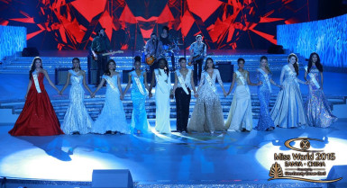 Miss Guyana Lisa Punch (fifth, left) on stage with the other finalists yesterday. (Miss World photo)