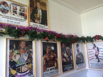 Framed photos of some of the honorees lining the walls of the Andrew 'Sixhead' Lewis Boxing Hall of Fame. Guyana first world champion, Andrew Lewis, the nation's lone Olympic medalist, Michael Parris, Wayne 'Big Truck' Braithwaite, Leon 'Hurry Up' Moore, Gwendolyn 'Stealth Bomber' O'Neil, Shondell 'Mystery Lady' Alfred, 'Vicious' Vivian Harris, Peter Abdool and brainchild of the HOF and former boxer turned journalist, Michael Benjamin are some of the individuals that have been honored with framed photos so far.