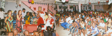 Composite photo shows Santa and Mrs Claus, patrons, volunteers and some of the children
