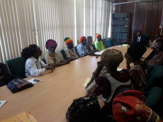 Attorney General Basil Williams at head of table with the representatives of Rastafarian organisations. (AG Chambers photo)