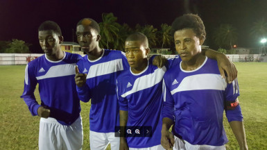 New Amsterdam United's scorers from left to right-Jermaine Samuels, Keon Williams, Jamal Butts and Lenardo Adams posing for the camera following their 7-0 drubbing of Black Water FC in the Banks Beer Football Championship Saturday at the Number Five ground.