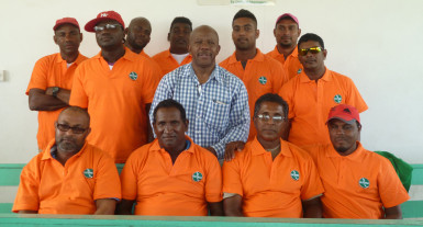 Moleson Creek bus drivers pose in their new uniforms with Director General of the Ministry of Tourism Donald Sinclair