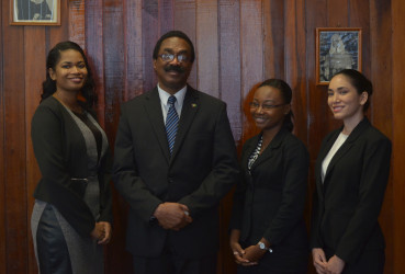 Attorney General Basil Williams poses with from left: 2013/2014 best student Narissa Leander, 2011/2012 best student Thandiwe Benn and 2014/2015 best student Eleanor Luckhoo