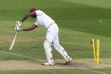 Captain Jason Holder is bowled first ball by fast bowler Peter Siddle on the second day of the second Test at Melbourne Cricket Ground yesterday. (photo courtesy of WICB media)