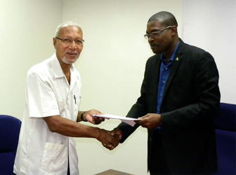 Chairman of BBCI Egbert Carter and Minister of Public Infrastructure David Patterson at the signing ceremony