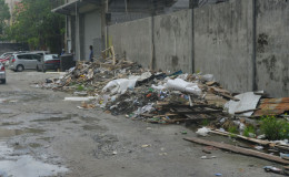 Builders' waste stored aback of the Holmes Street building.