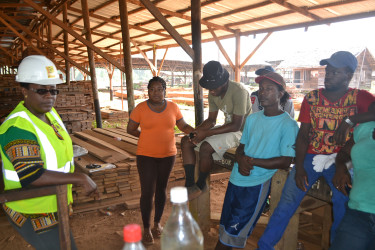 Simona Broomes with workers at Demerara Timbers