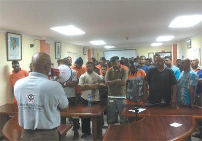 President of the Steel Workers Union, Christopher Henry, addresses employees of ArcellorMittal at the union's headquarters yesterday.