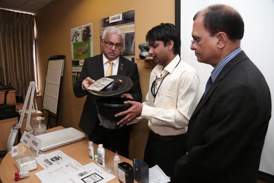 Health Minister Terrence Deyalsingh, left, holds a biological mosquito trap as entomologist Rajesh Ragoo, centre, explains how it works, while Chief Medical Officer Dr Clive Tilluckdharry looks on, during a media conference at the Ministry of Health, Park Street, Port-of-Spain, yesterday.