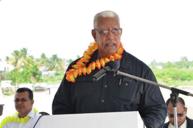 Minister of Agriculture Noel Holder addressing the gathering at the commissioning of the Lima pump station. At left is Region Two Chairman Devanand  Ramdatt. (GINA photo)