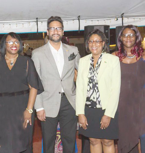 Minister of Tourism and Telecommunications Cathy Hughes (second from right) with Republic Bank (Guyana) Limited. Managing Director Richard Sammy (second from left) at Friday's reception.