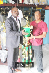Trophy Stall's Ramesh Sunich, right and one of the organisers of the event James Bond with the T20 trophy. Pix saved as Bond in sported