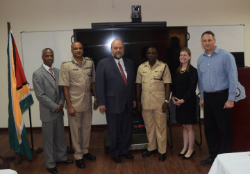From left to right  are U.S. Embassy INL Coordinator Leon Carr III, Guyana Police Force Commissioner Seelall Persaud, U.S. Ambassador Perry L. Holloway, Guyana Police Force Training Officer Paul Williams, MetroStar Systems Program Managers Christine Allgood, and Shai Segall.