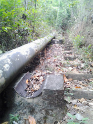 The landslide moved this steel pipe some distance away from the concrete structure where it once rested. This SN file photo was taken in 2013.