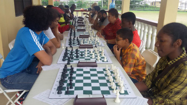 The January Trophy Stall tournament has created an opening for the Guyana Chess Federation to placidly observe for the remainder of the year. The tournament has generated the kind of activity that is required for chess, in that it has brought out the seasoned players and some young, bright faces. It means therefore, the young and the chess-matured still have an interest in playing the tantalizing brain game. The fervour has not waned. The photo shows another section of the participants doing battle at the Trophy Stall tournament.