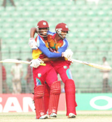 Keemo Paul (left) celebrates with Jyd Goolie after West Indies Under-19s beat Pakistan Under-19s in the quarter-final of the Under-19 Cricket World Cup here yesterday. (Cananews)