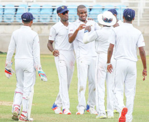 Fast bowler Miguel Cummins (second from left) celebrates another wicket during Barbados Pride's  victory yesterday. (Photo courtesy WICB Media)