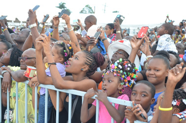 Wonderment: Part of the enthusiastic crowd at the flag raising yesterday at D'Urban Park (Keno George photo)