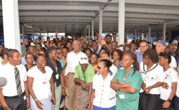 President David Granger with staff of Banks DIH (Ministry of the Presidency photo)