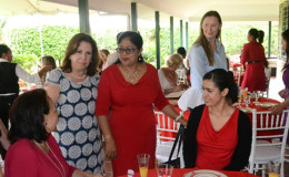 Wife of United States' Ambassador, Rosaura Holloway (second from left) and Mrs. Sita Nagamootoo (third from left), wife of Prime Minister Moses Nagamootoo at the  Valentine's  Day  brunch at the US Ambassador's residence in aid of Help and Shelter. (GINA photo)