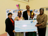 Marketing Manager Anjanie Hackett (left) presenting the cheque
