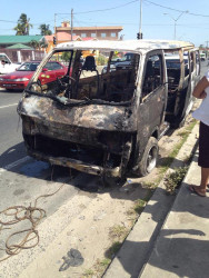 The front of the scorched minibus.