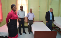 Minister of Public Health, Dr George Norton (right) and other officials checking out the beds in the maternity unit of the West Demerara Regional Hospital (GINA photo)