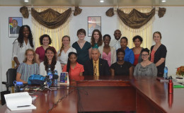 The Peace Corps Volunteers with Public Health Minister, Dr. George Norton  (GINA photo)