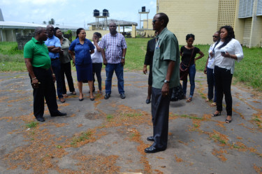 The newly elected executive of the North Ruimveldt Multilateral Secondary School Old Students Association in the school compound during their tour on Friday