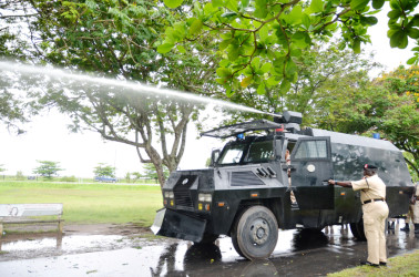 The water cannon spews water during a test in the National Park in June 2012. (Stabroek News file photo)