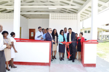 National Tuberculosis Programme Manager, Dr. Jeetendra Mohanlall along with the Minister within the Ministry of Public Health Dr. Karen Cummings cutting the ribbon to commission the Chest Clinic (GINA photo)