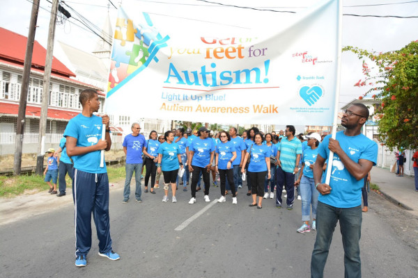 Those gathered for the  'Light it up blue' Autism Awareness walk. (Ministry of the Presidency photo)
