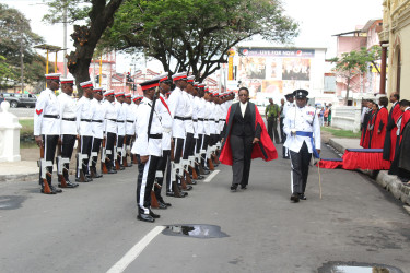 Justice Jo-Ann Barlow inspecting the guard of honour during yesterday's opening ceremony of the new Demerara Criminal Assizes at the High Court.
