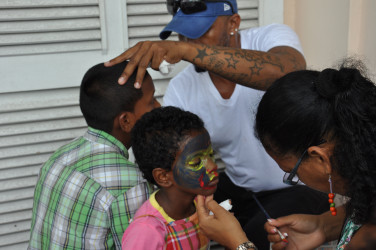 Children getting their faces painted. (Photo by Kellon Ferrier)