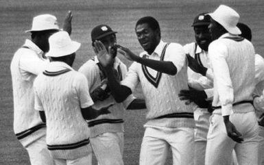 A 1980s West Indies team in congratulatory mode