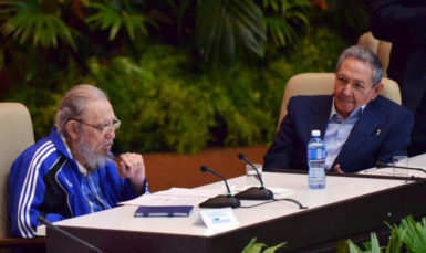 Cuba's former president Fidel Castro (L) sits next to his brother and Cuba's president Raul Castro during the closing ceremony of the seventh Cuban Communist Party (PCC) congress in Havana April 19, 2016. Omara Garcia/Courtesy of AIN/Handout via Reuters