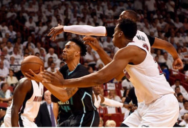 Charlotte Hornets guard Courtney Lee (1) is pressured by Miami Heat center Hassan Whiteside (21) and Miami Heat guard Dwyane Wade (3) during the first half in game five of the first round of the NBA Playoffs at American Airlines Arena. Mandatory Credit: Steve Mitchell-USA TODAY Sports