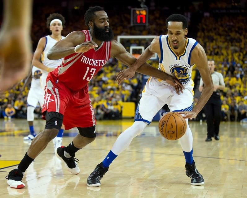 b24d509f11b8 Golden State Warriors guard Shaun Livingston (34) controls the ball against  Houston Rockets guard James Harden (13) during the third quarter in game  five of ...