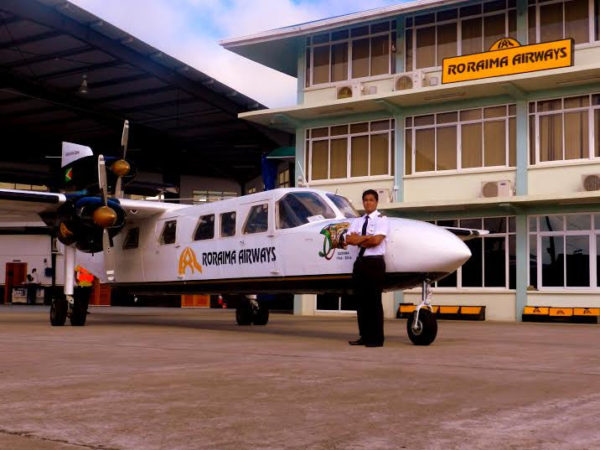 Roraima's 18-seater Trislander Aircraft with Captain Gerry Gouveia (Jr) standing next to it.