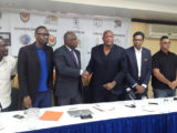 CBC President Glyne Clarke (3rd from left) and GABF President Nigel Hinds shaking hands following the signing of the agreement signaling Guyana as the host for the CBC u16 Male and Female Championships while CBC Vice President Patrick Haynes (2nd from right), NSC chief Christopher Jones (2nd from left) and YBG Director Chris Bowman (left) look on