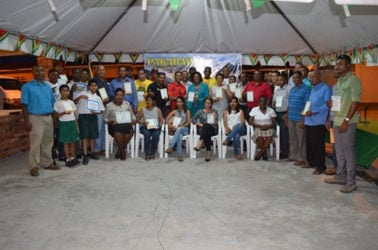 Participants of the 14th Pakaraima Mountain Safari with their certificates along with Minister of Telecommunication Catherine Hughes, Minister within the Ministry of Indigenous Peoples' Affairs, Valerie Garrido-Lowe (centre) and Director of the Guyana Tourism Authority, Indranauth Haralsingh (7th from left standing) (GINA photo)
